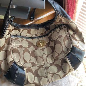 Turn lock hobo bag